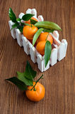 Ripe tangerines with leaves in a box Royalty Free Stock Photos