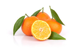 Ripe tangerines with leaves and slice Stock Images