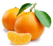 Ripe tangerines with leaves and slices Royalty Free Stock Photography