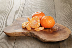 Ripe tangerines on olive board Royalty Free Stock Photography