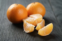 Ripe tangerines peeled on wood table Royalty Free Stock Photography