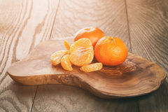 Ripe tangerines peeled on wood table Royalty Free Stock Photo