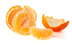 Ripe tangerines segments and rind Royalty Free Stock Photo