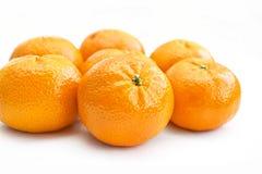 Ripe tangerines on white background Stock Photos