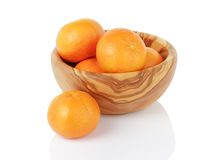 Ripe tangerines in wood bowl, isolated on white Stock Photo