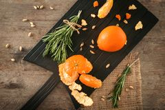 Ripe tangerines on wooden board. Fresh citrus fruits stock image