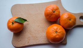 A ripe tangerines on a wooden deck royalty free stock image