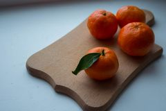 A ripe tangerines on a wooden deck stock photography