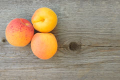 Ripe Tasty Apricots on the Old Wooden Table Royalty Free Stock Image