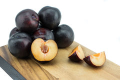 Ripe tasty plums on the wooden board stock photos