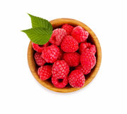 Ripe and tasty raspberries isolated on white background. Raspberries in a wooden bowl. Ripe and tasty raspberries isolated on white background. Top view Stock Photos