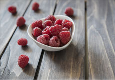 Ripe Tasty Raspberries On Wooden Background.Selective focus. Ripe tasty raspberries on wooden background. Healthy and diet food. Organic berries. Selective focus Stock Images