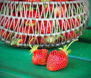 Ripe and tasty strawberries metal a basket in the street on  green bench Stock Photos