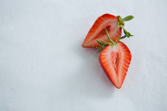 Ripe tasty strawberry cut into two halves Stock Photography