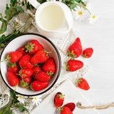Ripe and tasty strawberry on a white wooden table. Strawberry. Harvest Royalty Free Stock Photo
