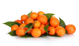 Ripe tasty tangerines with leaves Royalty Free Stock Photo