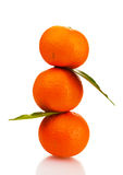 Ripe tasty tangerines with leaves Royalty Free Stock Images