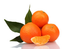 Ripe tasty tangerines with leaves and segments Royalty Free Stock Image