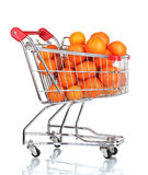 Ripe tasty tangerines in shopping cart Royalty Free Stock Images