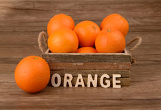 Ripe tasty tangerines in wooden box Royalty Free Stock Image