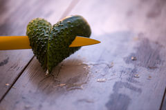 Ripe tempting vegetables. Two halves of the cucumber in the form of little heart Stock Images