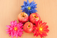 Ripe three red apple with artificial flower Stock Image