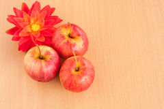 Ripe three red apple on plywood backgroun Royalty Free Stock Photography