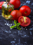 Ripe tomato, basil and olive oil Royalty Free Stock Photo