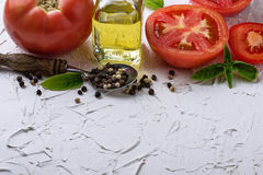 Ripe tomato, basil and olive oil Royalty Free Stock Image