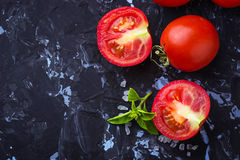 Ripe tomato, basil and olive oil Royalty Free Stock Photography