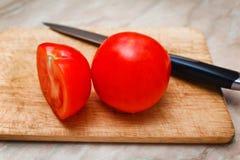 Ripe tomato cut segment on board Royalty Free Stock Photos