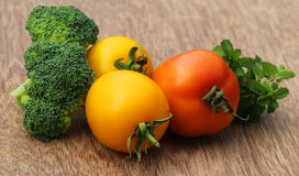 Ripe tomato with mint leaves and broccoli Royalty Free Stock Photo