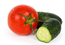 Ripe tomato and sliced cucumber Stock Photos