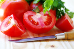 Ripe tomato sliced  and knife Stock Photography