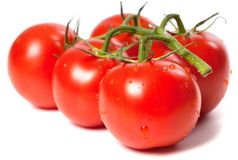 Ripe tomato with water drops Royalty Free Stock Image