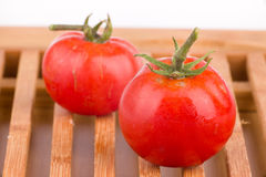 Ripe tomato on wooden grid Royalty Free Stock Photography