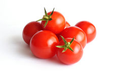 Ripe tomatoes. Pile of ripe red tomatoes isolated on white background Royalty Free Stock Image