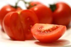 Ripe tomatoes. Rip tomatoes on white dish Royalty Free Stock Photos