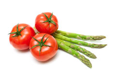 Ripe tomatoes and asparagus isolated on a white background Stock Images