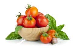 Ripe tomatoes, basil, garlic Stock Images