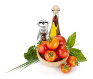 Ripe tomatoes, basil, olive oil, pepper Stock Images