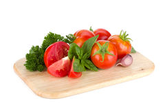 Ripe tomatoes, basil and parsley Royalty Free Stock Photography