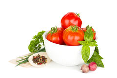 Ripe tomatoes, basil and parsley Royalty Free Stock Image