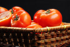 Ripe tomatoes in basket Stock Image