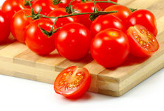 Ripe tomatoes on the board Royalty Free Stock Photography