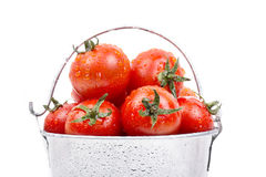 Ripe tomatoes in a bucket Stock Photo