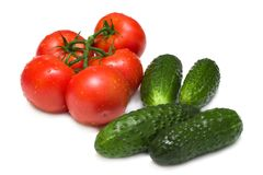 Ripe tomatoes and cucumbers Stock Photos