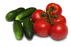 Ripe tomatoes and cucumbers Stock Photography