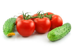 Ripe Tomatoes and Cucumbers Isolated on White. Background Stock Photo