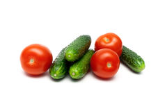 Ripe tomatoes and cucumbers  on white background Royalty Free Stock Photos